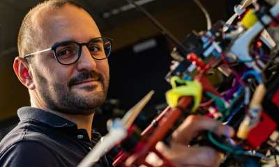 Rice University postdoctoral researcher Riccardo Petrolo shows one of several autonomous aerial drones being prepared to monitor for pollutants.
