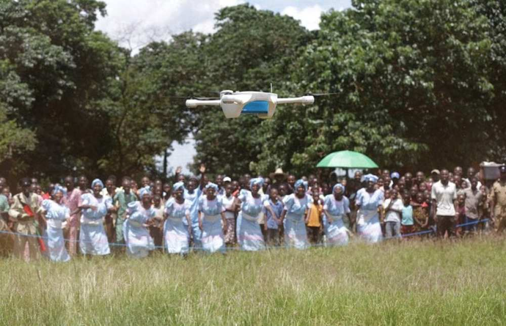 Children look on as the United Nations Children's Fund and the Government of Malawi test the use of unmanned aerial vehicles to reduce waiting times for infant HIV tests. Credit: UNICEF/Khonje