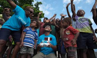 Jospeh Hing and Rebecca Olul introiducing the chgildren of Epi to the magic of drones and how they will be part of a world first drone delivery of vaccines trial to be held in Vanuatu. Credit: UNICEFPacific/2018/Chute
