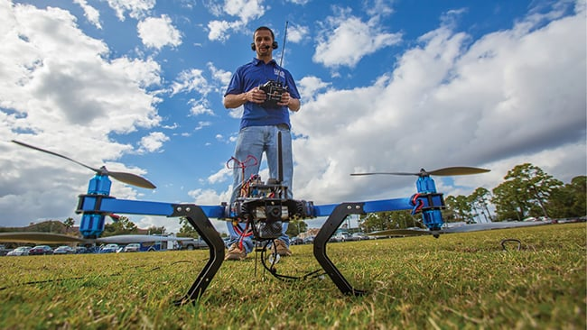 student prepares to launch drone