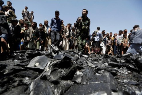 People gather around the engine of a drone aircraft which the Houthi rebels said they have downed in Sanaa, Yemen October 1, 2017. REUTERS:Khaled Abdullah 4