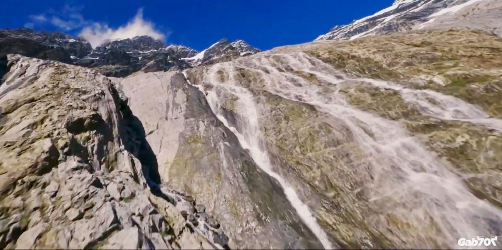 Race drone soars like a bird along Swiss mountain tops [video]