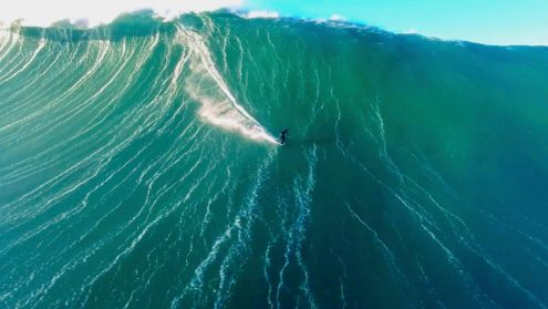 A bird's-eye view of a colossal Nazaré peak lumbering behind Sebastian Steudtner. Video: Cameron Calistro