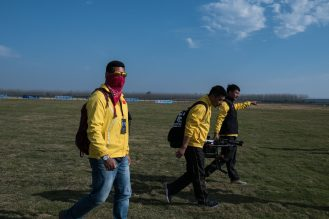 Members of a team from Guangdong Province carrying a drone during a competition involving industrial-grade drones. Credit Lam Yik Fei for The New York Times