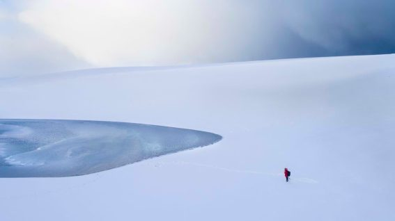 A sand dune where the snow was blown down. The phantom lake that appears there.