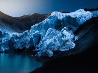 Glaciers dramatically lit up at night by a drone 4