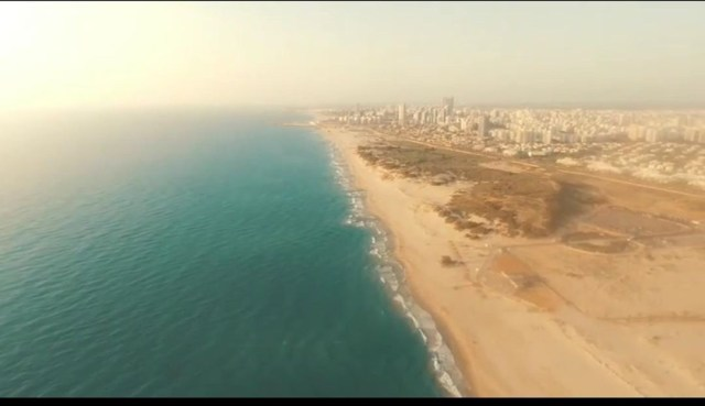 This is a photo from the drone photography bible review of the parrot bebop 1.0. The photo was taken in israel and is a beach and the sea.
