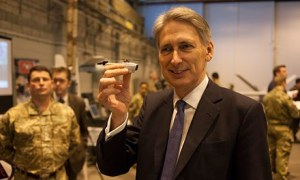 Defence Secretary Philip Hammond holds a Black Hornet drone at RAF Waddington