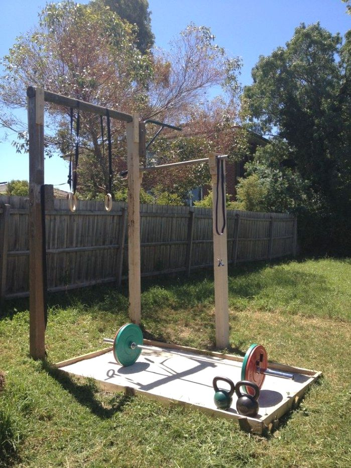 This garden gym setup is geared towards strength training with a Olympic barbell, lifting platform and ring pull-up station.