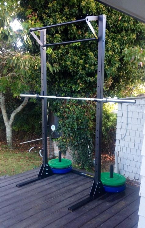 A professional rack with Olympic barbell.