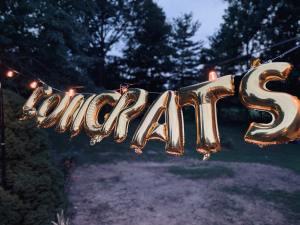 "Gold balloons spell 'congrats"""