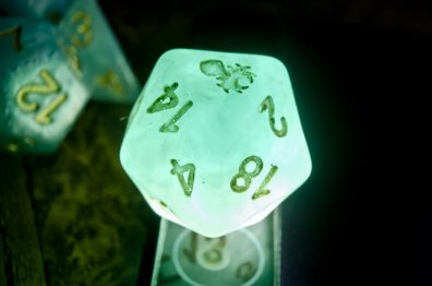 Bun Hair Excluded, these dice have nearly no internal flaws, giving them that not-quite-opaque look. The lettering tho... yikes.