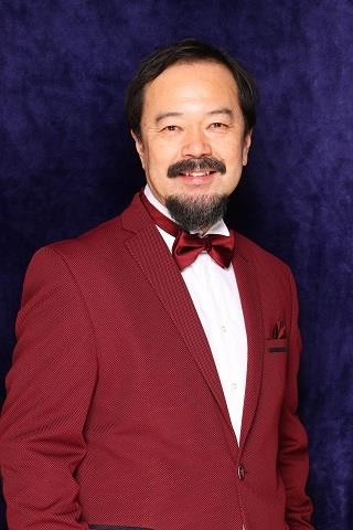 A person in a red suit  Description automatically generated with medium confidence