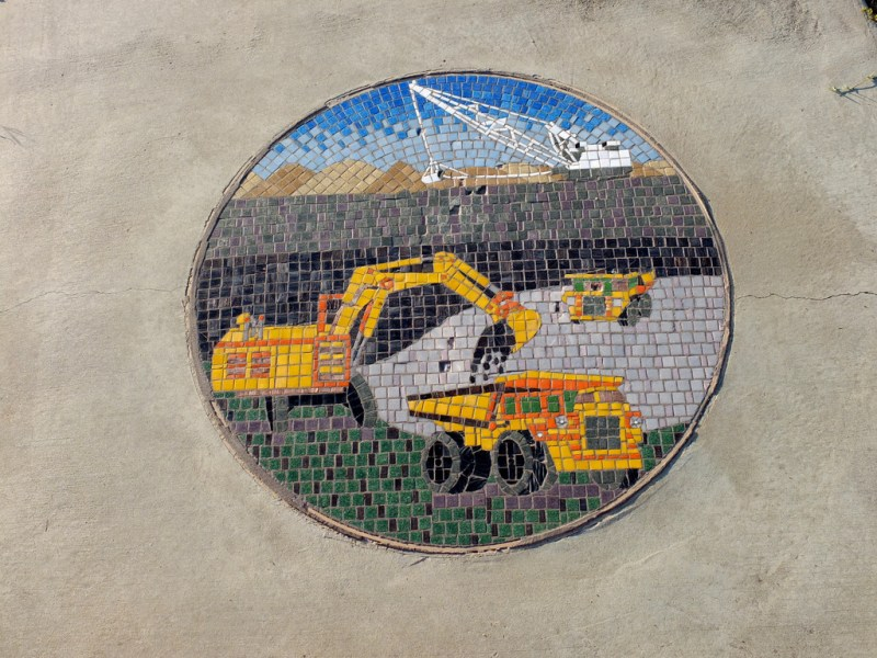 The communities pride in their coal mining is shown in this footpath mosaic in Emerald