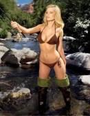 Fishing girl in waders and bikini