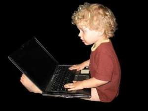 little boy laptop - The Expanding Role of Digital Literacy in the Traditional Classroom
