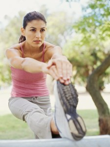 young woman exercising in a park