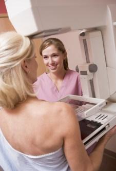 Nurse Assisting Patient Undergoing Mammogram