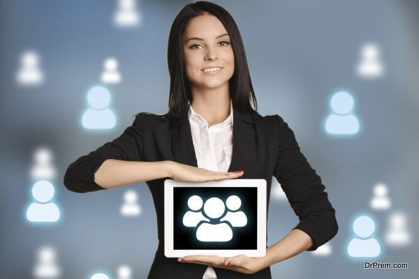 Young girl holding tablet with icon people team.
