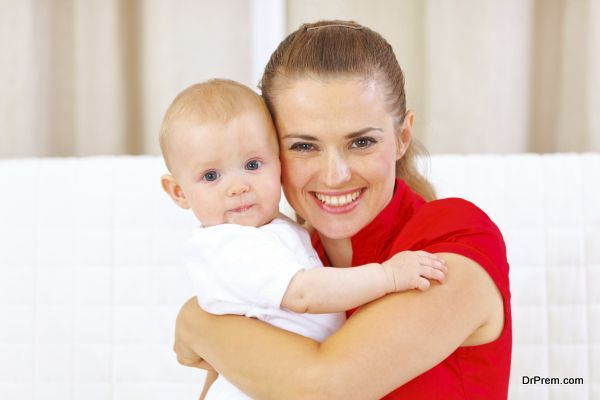 Portrait of lovely baby and young mother