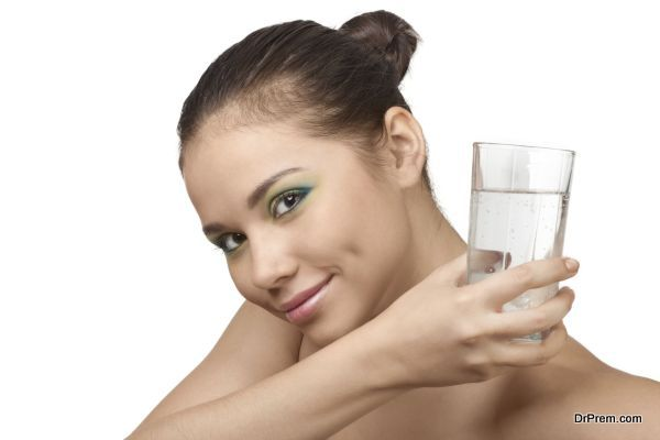 Smiling girl with glass of water