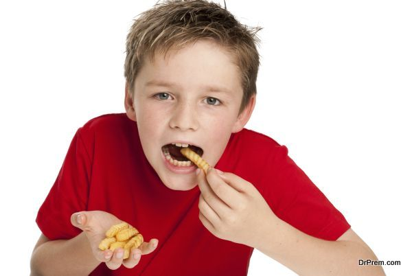Handsome Young Boy Eating Fries