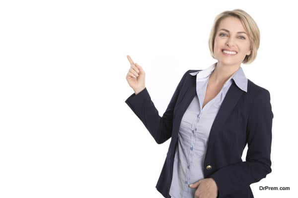 Isolated attractive blond woman pointing with index-finger.