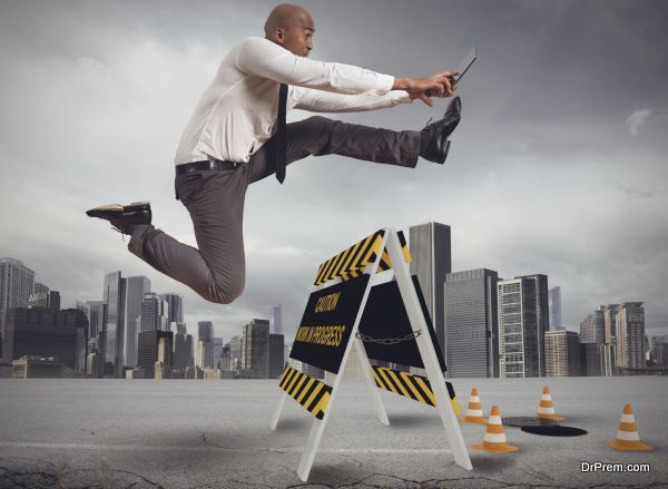 Businessman distracted trying to overcome a hazard