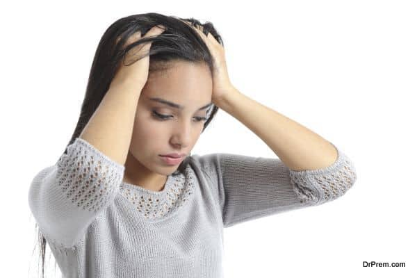 Arab woman worried with the hands in the head isolated on a white background