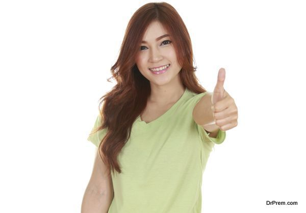 woman in blank green t-shirt with thumbs up isolated on white background