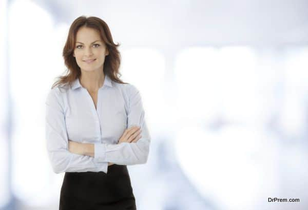Beautiful modern businesswoman standing in her office.