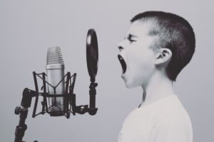 Image of singing to discuss the importance to HRV