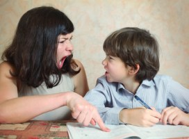 mother try to help her son to do difficult task