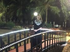 Anna on a bridge in the garden