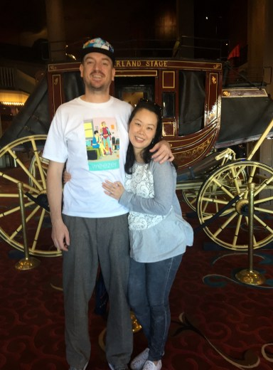 Looking stoned in front of a stagecoach