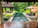 Looking over our private pool and spa