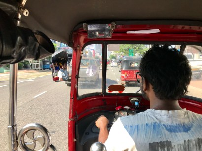 In a tuk tuk en route to the station (note the sealed metre)