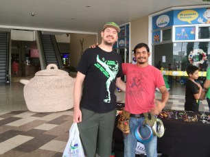 A guy who makes wire ornaments in a mall that wanted a picture with me