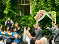 Kat and Robin taking their vows