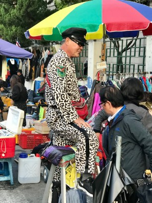 This flamboyant looking man was the king of the jacket sellers