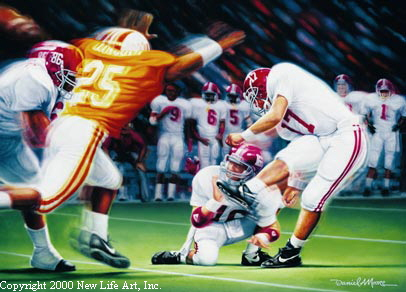 """To Kick or Not to Kick.""  Bill Curry's eventual departure after the season had a lot to do with his decisions in the kicking department.  Philip Doyle, shown here the following season kicking a game-winner vs. Tennessee, was an integral part of the '89 Iron Bowl.  His counterpart in blue, Win Lyle, was too."
