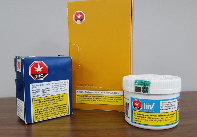 Three legal marijuana products are neatly arranged on table