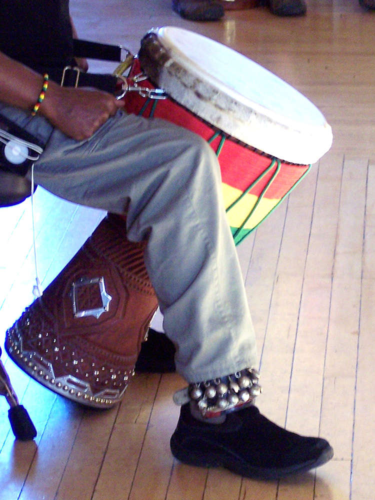 Fig. 10: Notice how Mamady Keita uses the strap to balance the drum and let his legs relax.