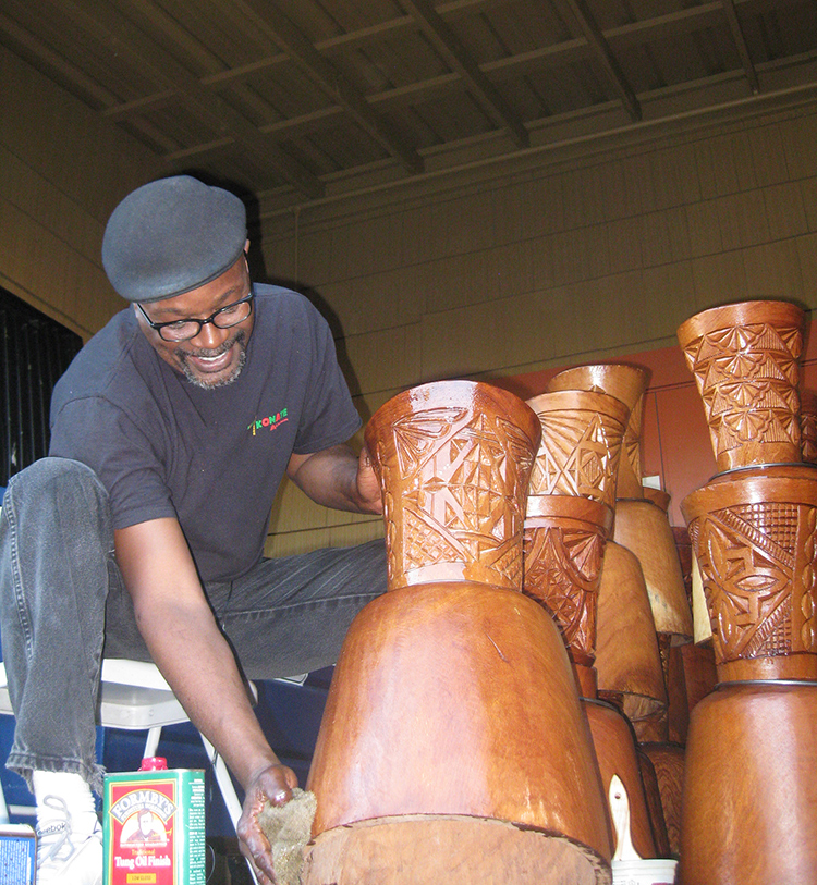 Fig. 3 Drum builder Bryan Hopkins uses Tung oil to condition Guinea djembes.