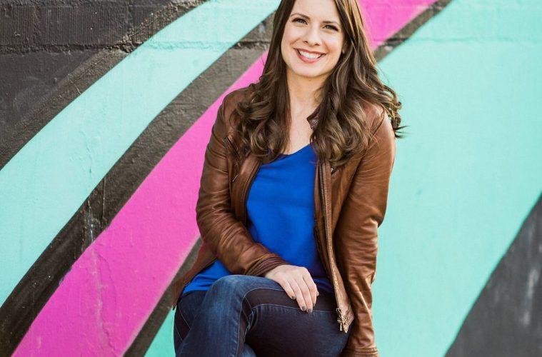 Kassandra Kocoshis sitting on cajon drum. Photo by Julie Shuford