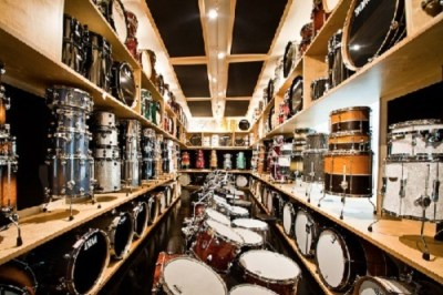 Stack of drums on shelves in a drum shop