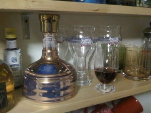 Samuel Adams Utopias bottle and snifter with a few ounces of Utopias poured in