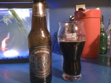 A bottle of Samuel Adams Chocolate Bock and a pint of it poured into a glass.