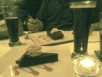 Two glasses of Black Duck Porter and two flour-less chocolate cakes
