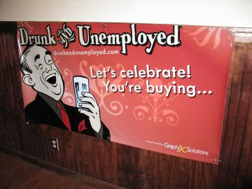Drunk and Unemployed banner on the wall of the Cortland